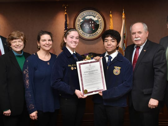 Union County Freeholder Chairman Sergio Granados, Vice Chairman Bette Jane Kowalski and Freeholder Alexander Mirabella present a resolution to Union County Vocational-Technical Schools Superintendent Peter Capodice, National FFA (formerly Future Farmers of America ) advisor and horticulture instructor Bonnie Baldasare and FFA members Colleen Clarke of Rahway and David Tohon of Linden designating the week of Feb.17 through Feb 24  as National FFA Week in Union County.