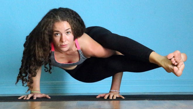 Yoga instructor Angela Firewalker goes through a series of poses at Mind & Body studio at 631 N. Resler. Firewalker and other top yoga instructors from the El Paso area will team up to host the third annual Sunrise Yoga Festival on Sunday at Sun Bowl Stadium.