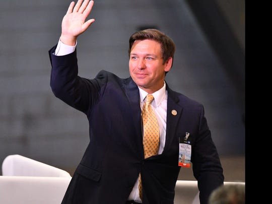 Congressman Ron DeSantis waves to the crowd at the KSC's Vehicle Assembly Building.