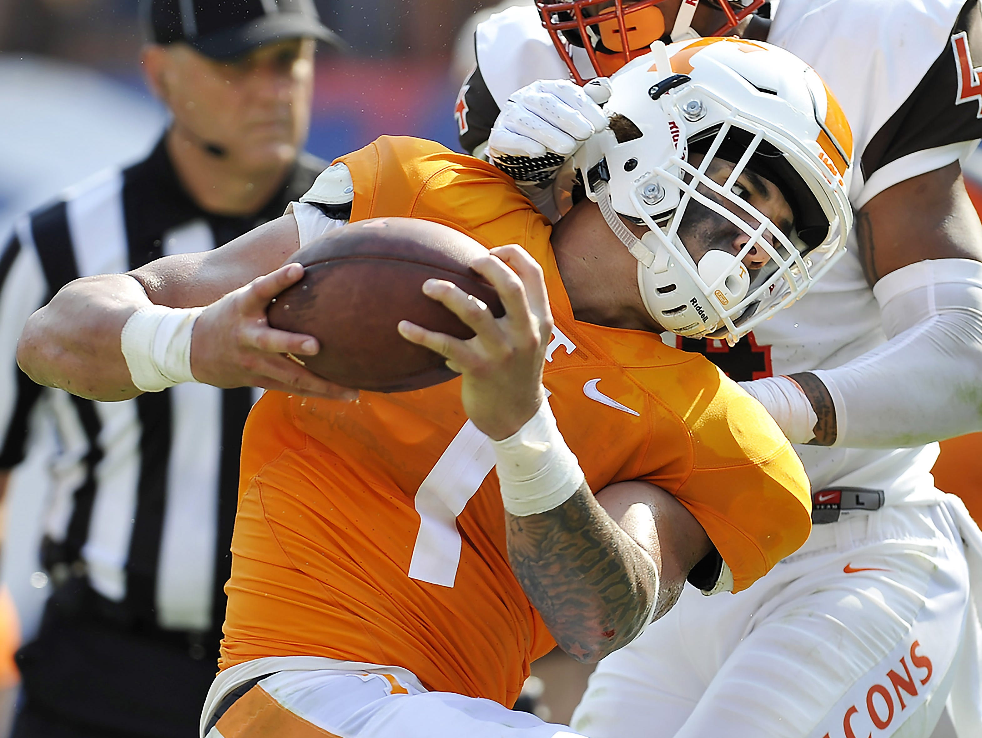 Tennessee running back Jalen Hurd (1) powers past Bowling Green defensive back Eilar Hardy (4) during the game in September.