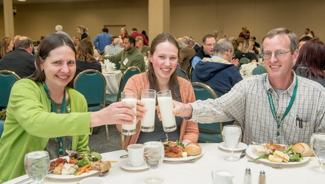 Farmers raise a milk toast to the 18th annual Vermont Dairy Producers Conference at the Sheraton in South Burlington on Tuesday.