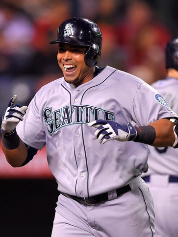 Nelson Cruz celebrates after hitting a solo home run.