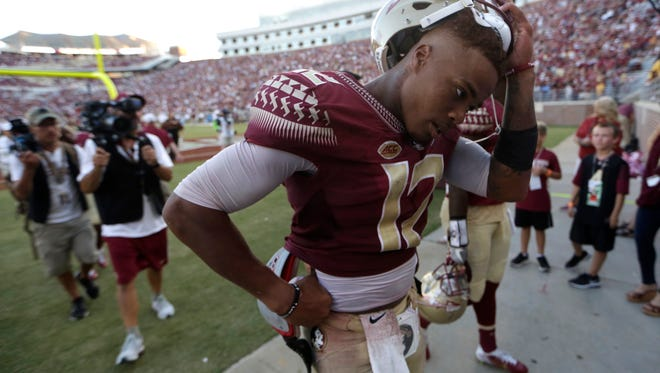 FSU's Deondre Francois walks off the field after UNC's 37-35 win on a field goal as time expired at Doak Campbell Stadium on Saturday.