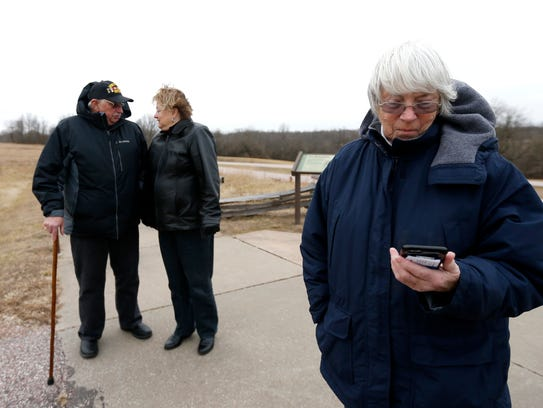Marjorie Tardiff listens to an audio recording at an interpretive stop on the tour road at Wilson's Creek National Battlefield as Joe and Karen Ganger listen nearby on Monday, Jan. 22, 2018. While the visitor center to the park was closed, the gate was open, allowing visitors to take a self-guided tour.