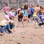 Kids attending the Choteau Ranch Rodeo race after candy bars during a break in the competitive cattle-working event at the Choteau Rodeo Grounds. This year's event takes place Saturday, Sept. 5 starting at noon.