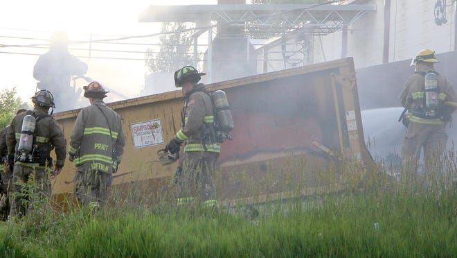 Firefighters attack a fire in a dumpster from both ends. The dumpster was behind Orscheln Farm & Home store in Pratt and had roofing materials on fire inside. There was no obvious reason for the fire and it was quickly extinguished by the firefighters.