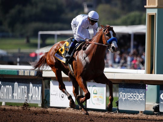Justify, ridden by Mike Smith, crosses the finish line to win the Santa Anita Derby horse race at Santa Anita Park, Saturday, April 7, 2018, in Arcadia, Calif. (AP Photo/Jae C. Hong)