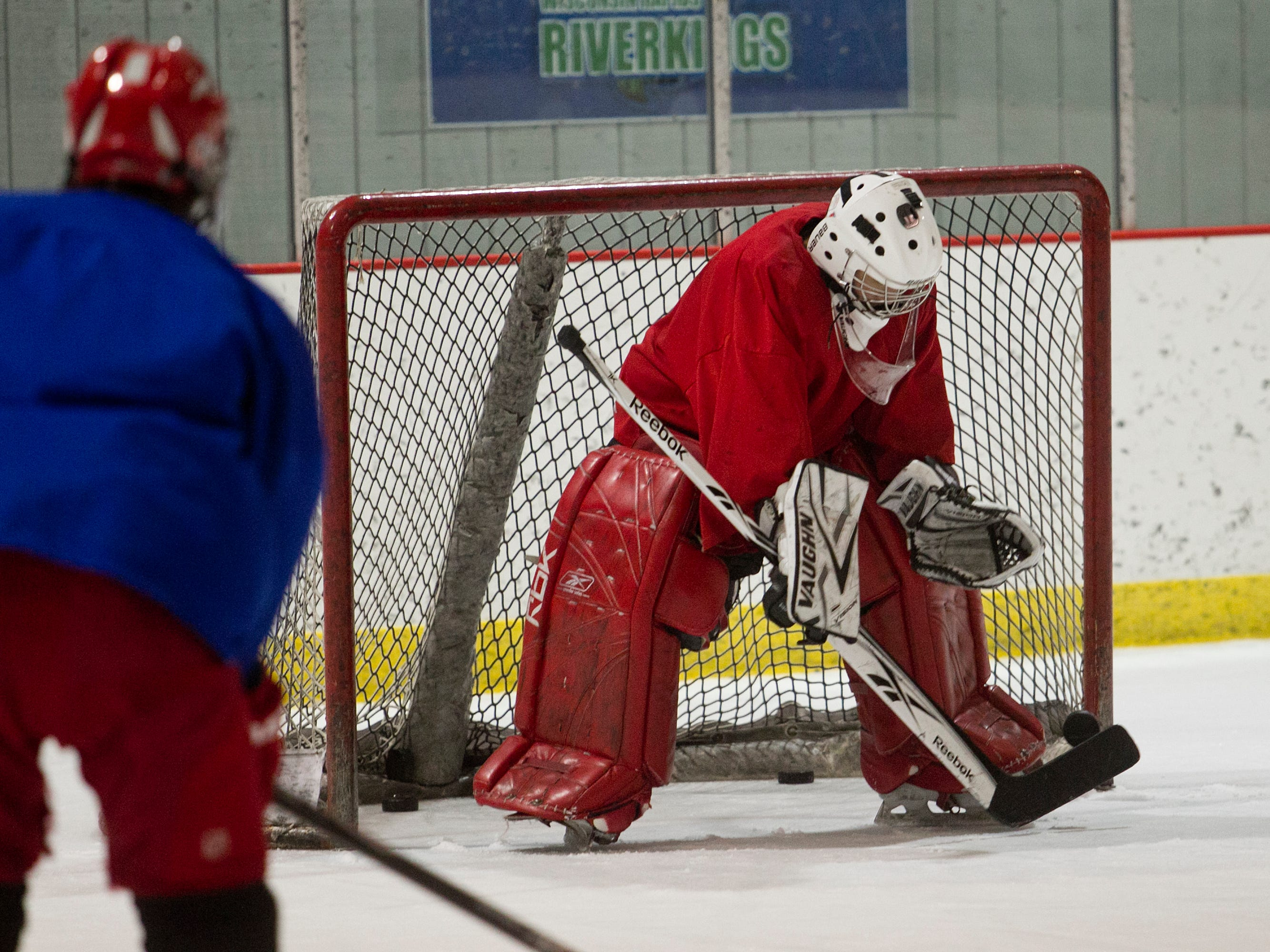 Daily Tribune Media sports reporter Mark Massoglia stands in as goalie during Wisconsin Rapids hockey practice Friday at the South Wood County Recreation Center in Wisconsin Rapids.