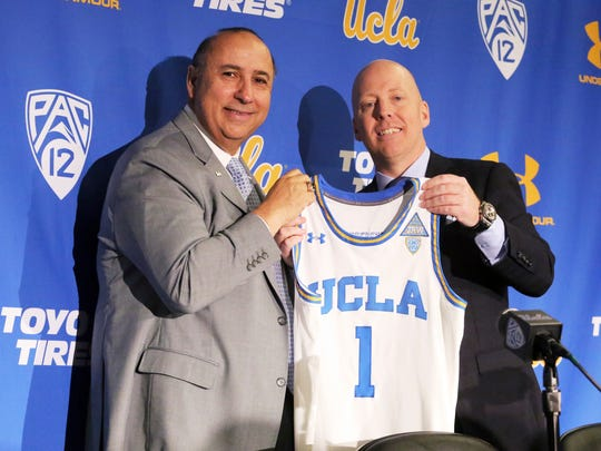 Mick Cronin, right, and athletic director Dan Guerrero pose as Cronin is introduced as UCLA's new head basketball coach at a news conference on the campus in Los Angeles Wednesday, April 10, 2019. Cronin was hired as UCLA's basketball coach Tuesday, ending a bumpy, months-long search to find a replacement for the fired Steve Alford. The university said Cronin agreed to a $24 million, six-year deal. (AP Photo/Reed Saxon)