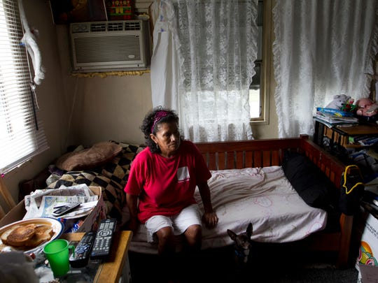 Miriam Martinez's trailer was destroyed in the storm, and she lived at a church for more than a month.