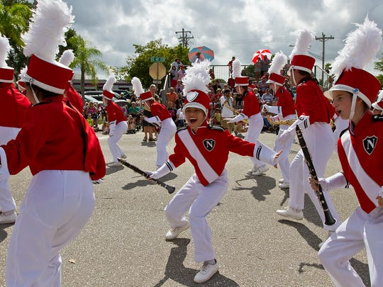 Members of the North Fort Myers High School marching band perform along SE 47 Terrace in downtown Cape Coral Wednesday morning November 11, 2015, during the annual Veterans Day Parade.