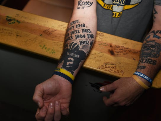 michigan fan inked with 12 wolverines themed tattoos. Black Bedroom Furniture Sets. Home Design Ideas