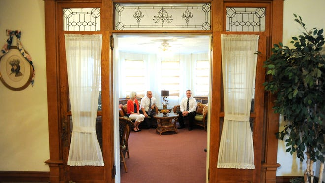 Michele, David and Dustin Baker talk about how the family came to Utica in the sunroom of the Law-Baker Funeral Home.