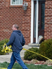 A fire investigator removed police tape from the scene a fatal fire in Saratoga Woods subdivision where four people died in an apparent murder-suicide.