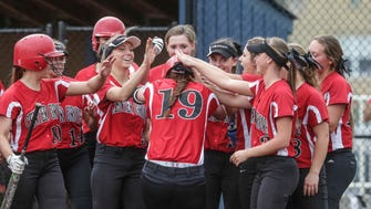 Center Grove's Jordyn  Rudd  #19, is congratulated by team mates after hitting a home run over the fence, as Cathedral High School   takes on Center Grovel at Cathedral, Wednesday April 20th, 2016.