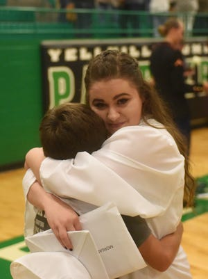 A Yellville-Summit graduate gts a hug from a loved one folloing Friday night's ceremony.