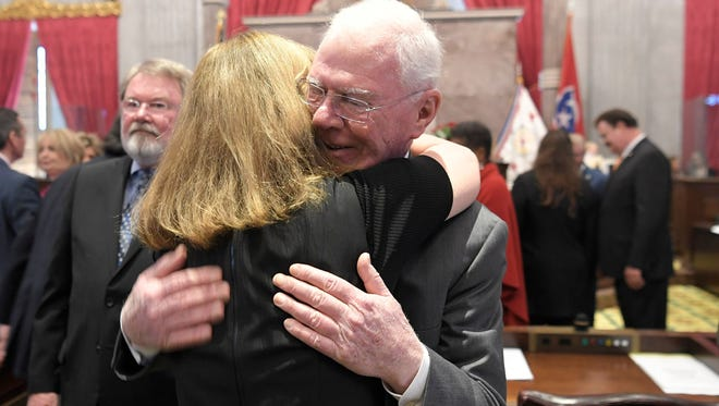 Tennessee Rep. Charles Sargent hugs House Speaker Beth Harwell after the House members honored her for her service during session April 10, 2018. Both Harwell and Sargent are leaving the House of Represntatives.