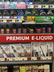 Oils used in vaping devices, along with smokeless tobacco at the Rickers location at E. Hanna and S. East Streets, Indianapolis, Friday, June 17, 2016.