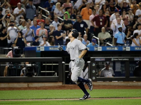 New York Yankees' Aaron Judge reacts as he runs the bases after hitting a home run during the fourth inning of a baseball game against the New York Mets Wednesday, Aug. 16, 2017, in New York. (AP Photo/Frank Franklin II)