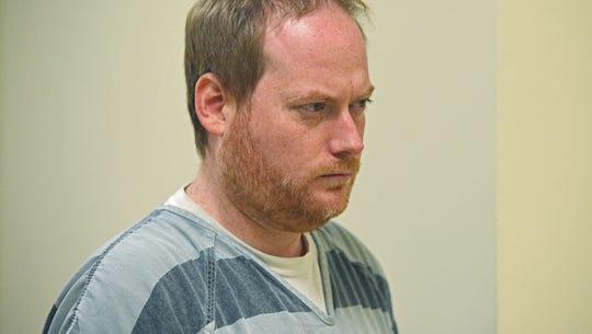 Jonathan David Cohen, 36, is escorted into Minnehaha