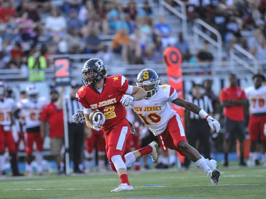 James Fara of Point Boro, runs for yards after a catch in the North-South Football Classic at Kean University in Union on June 26, 2018.