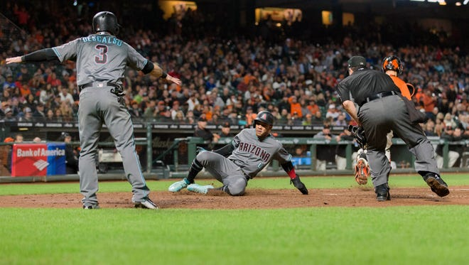 Sep 15, 2017: Arizona Diamondbacks shortstop Ketel Marte (4) gets around the tag by San Francisco Giants catcher Nick Hundley (5) to score during the seventh inning at AT&T Park.