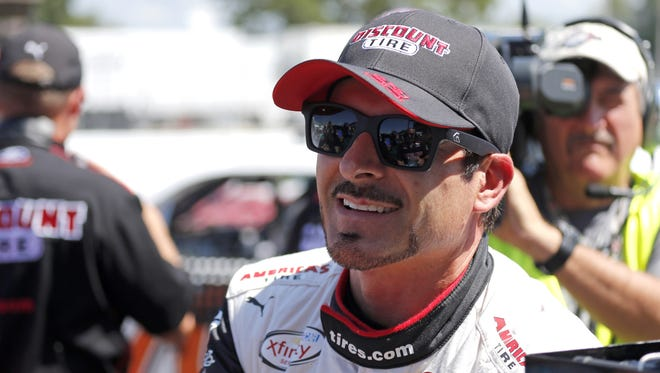 Alex Tagliani on pit road during qualifying for the NASCAR Xfinity Series Nationwide Children's Hospital 200 auto race at Mid-Ohio Sports Car Course Saturday, Aug. 15, 2015 in Lexington, Ohio.