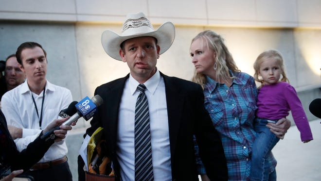 Ryan Bundy, center, walks out of federal court with his wife Angela Bundy on Nov. 14, 2017, in Las Vegas.