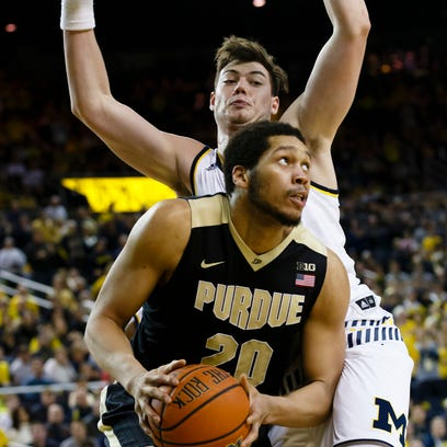 Purdue center A.J. Hammons (20) is defended by Michigan
