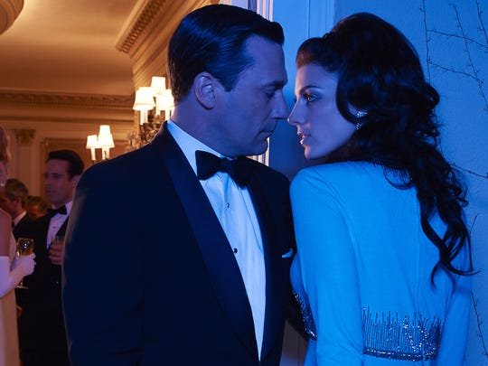 In his signature role: Jon Hamm and Jessica Pare play