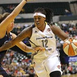 Indiana Fever forward Lynetta Kizer drives to the hoop around Connecticut forward Kayla Pedersen in the first half of the game at Bankers Life Fieldhouse on Sunday, August 2, 2015. The Fever defeated Connecticut 83-70.