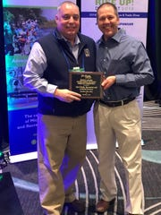 Novi parks director Jeff Muck, left, with Brett Kaschinske, president of the Michigan Recreation and Park Association, as Muck is presented with a Facility Design Award for Pavilion Shore Park.