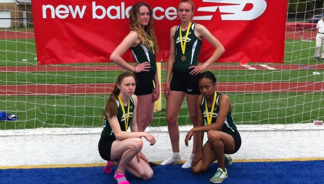 St. Johnsbury's Hannah Ryan, Quinnae Outerbridge, Grace Cooke and Bettina Hammer pose after breaking the 4x400 state record.