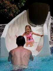 Lyla Curtin, 4, slides down to her dad at the Phoenician resort.