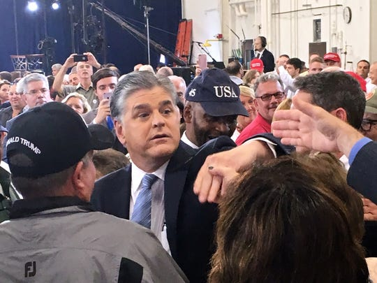 Fox News show host Sean Hannity greets the crowd at the Pennsylvania Air National Guard base in Harrisburg where President Donald Trump spoke about his tax reform plan.