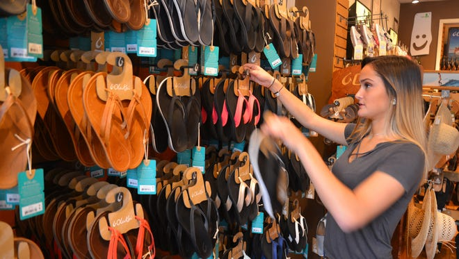 Many small businesses are expecting a busy day Saturday for Small Business Saturday. Sales associate Jessica Genereux was getting ready for Saturday at The Flop Shop in downtown Melbourne.
