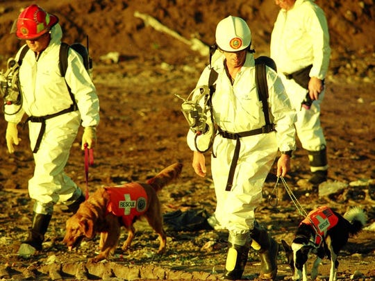 Law enforcement officers and dogs search the Martin County Landfill for Andrea Parsons after her disappearance in 1993.