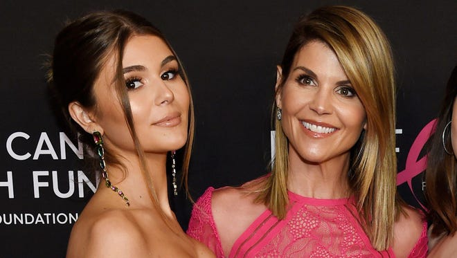 """In this Feb. 28, 2019 file photo, actress Lori Loughlin poses with her daughter Olivia Jade Giannulli, left, at the 2019 """"An Unforgettable Evening"""" in Beverly Hills, Calif. Loughlin has been charged with fraud in a scheme to get Gianulli into the University of Southern California."""