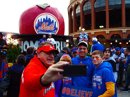 Marlins Man poses for a photo with Mets fans before Game 4 of the World Series against the Royals at Citi Field in N.Y. on Oct. 31, 2015.