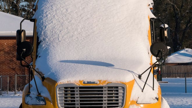 A school bus covered with snow in Montgomery, Al., on Wednesday morning January 17, 2018.