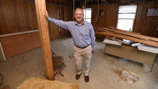 Flippin Mayor Jerald Marberry stands in torn down portion of the city's municipal building on Tuesday. The city plans to spend approximately $300,000 to revamp the building.