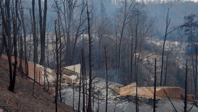 Destroyed houses as far as the eye can see Tuesday, Nov. 29, 2016, in Gatlinburg, Tenn. A wildfire ravaged the area leaving at least three people dead.