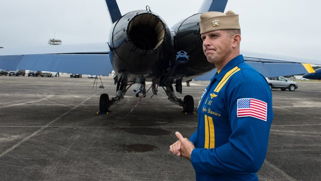 Lt. Tyler Davies, a pilot with the Blue Angels, talks about the operations of his F/A-18 Hornet fighter jet at Wallops Flight Facility on Thursday, June 15, 2017. Davies will perform in Ocean City this weekend as an opposing solo, which involves aerobatic maneuvers.