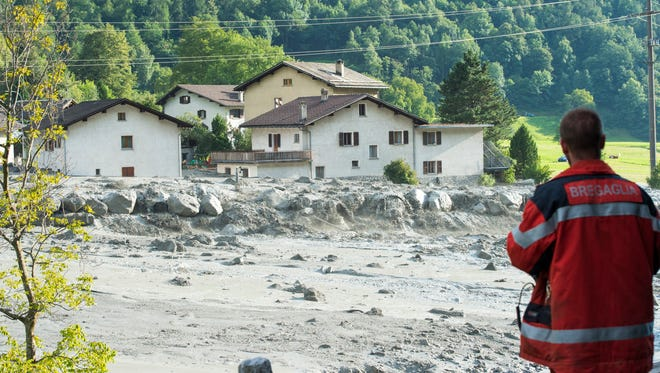 In this photo taken Wednesday, Aug. 23, 2017 shows a landslide that hit the village Bondo in southern Switzerland.