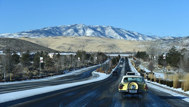 Peavine Peak, seen from Vista Boulevard in Wingfield Springs, got a brushing of snow from the first snow of the season on Wednesday morning Dec. 20, 2017.