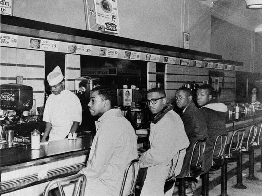 Joseph McNeil, foreground, and three other men sit in at a lunch counter in Greensboro, N.C., in 1960.