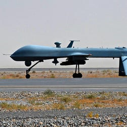 File photo:  - A U.S. Predator unmanned drone armed with a missile stands on the tarmac of Kandahar military airport in Afghanistan.