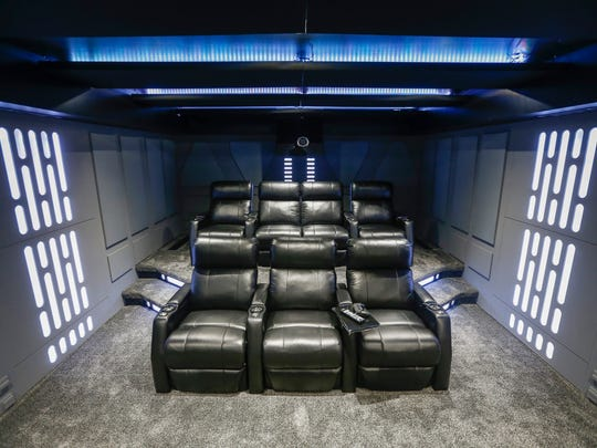"Patrick Williams designed a ""Star Wars""-themed home theater in his home in Nixa. Here, the lights are all white to resemble the Death Star."
