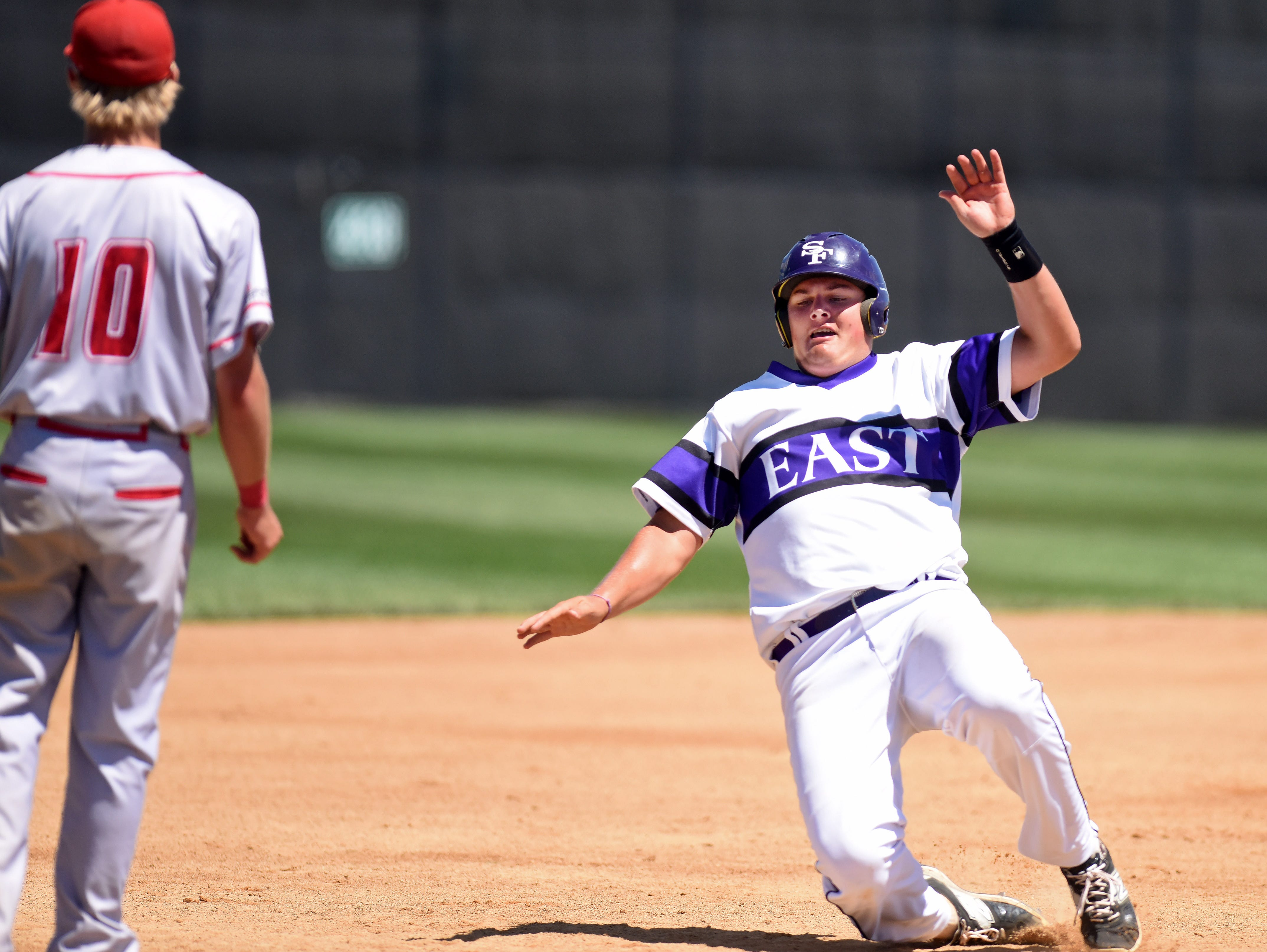 Sioux Falls Post 15 East's Evan Kuhnert slides safely into third base against Rapid City Post 320 during the American Legion Class A Baseball State Tournament at Harmodon Park on Saturday afternoon.