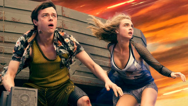 """Dane DeHaan (left) and Cara Delevingne save the day in """"Valerian and the City of a Thousand Planets."""""""